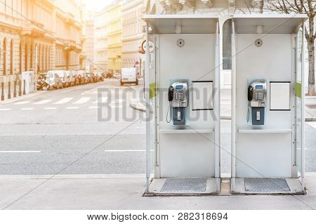 Pair Of Payphone Booth In Vienna Center Street. Two Modern Public Phones On European City Street. Co