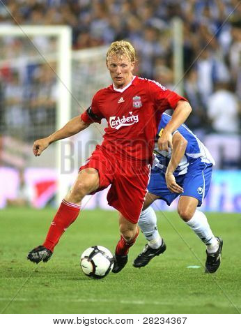 BARCELONA - AUGUST 2: Dirk Kuyt, Dutch player of Liverpool FC, in action during a friendly match against RCD Espanyol at the Estadi Cornella-El Prat on August 2, 2009 in Barcelona, Spain.
