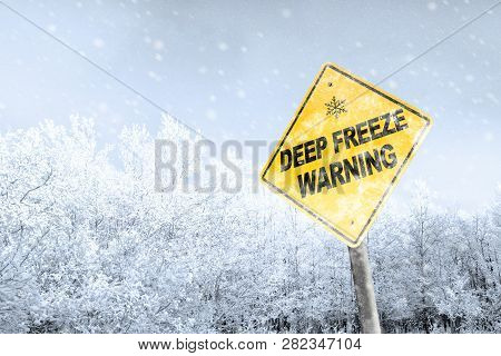 Winter Season Deep Freeze Polar Vortex With Snowflake Symbol Sign Against A Snowy Background And Cop