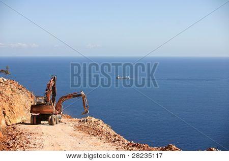 Excavator constructs road
