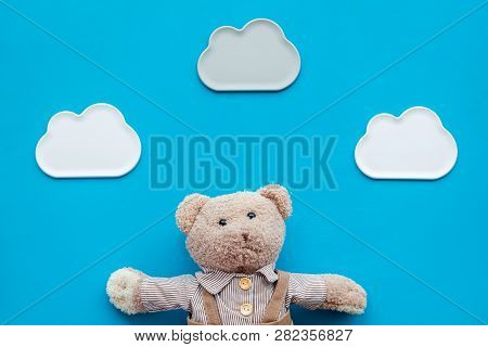 Baby Care. Newborn Baby Concept. Baby Sleep Concept. Teddy Bear Toy Near Clouds On Blue Background T