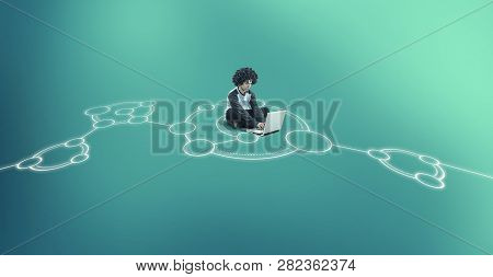 Man Working On Laptop In The Middle Of A Network Sketch Drawn On The Ground.