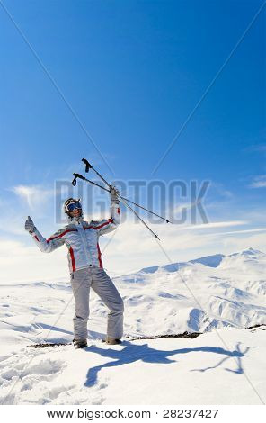 Beautiful Skier On The Top Of Mountain