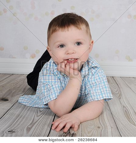 Sweet Little Boy Posing For Camera