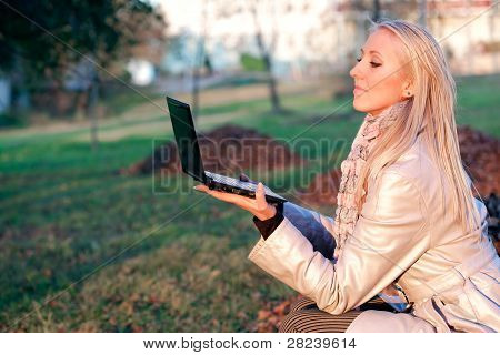 Cute student girl with laptop