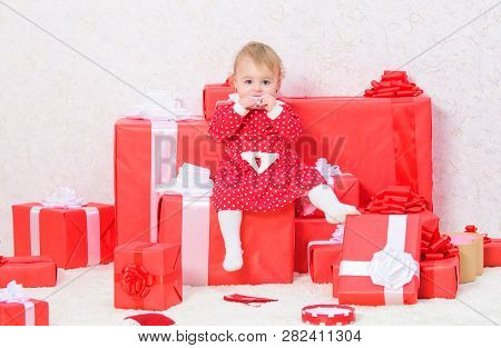 Little Baby Girl Play Near Pile Of Gift Boxes. Family Holiday. Christmas Gifts For Toddler. Gifts Fo
