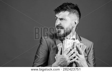 Man Bearded Businessman Hold Pile Money Blue Background. Businessman Surprised Feels Like Thief With