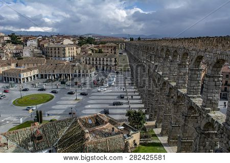 Segovia, Spain: March 2015: Scenery Of The Acueduct Of Segovia, Top View Of Old Building Towns In Se