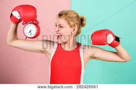 Girl Athlete Boxing Gloves And Alarm Clock. Sport Lifestyle And Healthy Regime. Habits And Regime Co