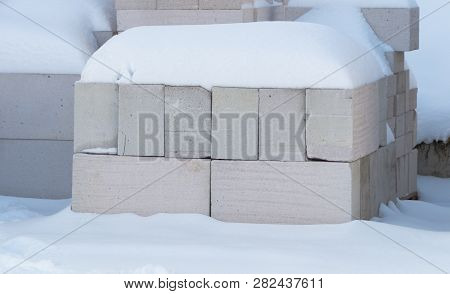 pallets with bricks in the building store. Racks with brick. Masonry, stonework. poster