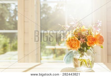 Valentines Day, Orange English Rose Flowers In A Glass Jar On The Background Of A Large Window Of A