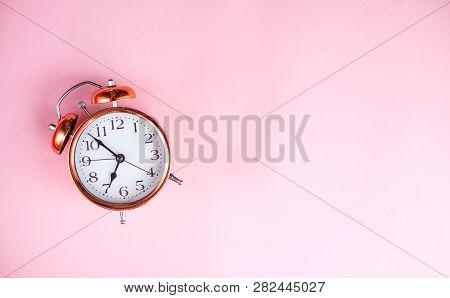 Alarm Clock On A Pink Background. Clock.