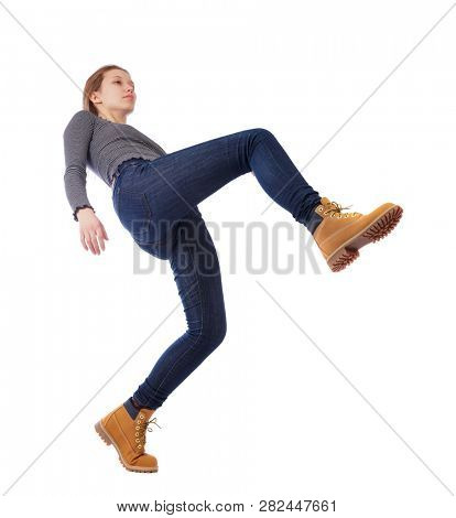 Balancing young woman.  or dodge falling woman. Rear view people collection.  backside view of person.  Isolated over white background. The young girl is balancing on one leg, strongly leaning back.