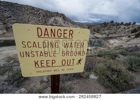 Sign warns of scalding water in the Hot Creek Geological Area near Mammoth Lakes California, in the Eastern Sierra Nevada Mountains poster
