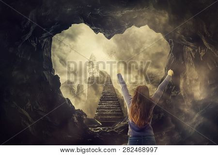 Surreal Freedom Concept, Woman Rear View Raising Hands Up In Front Of A Mystic Stairway Going Up To