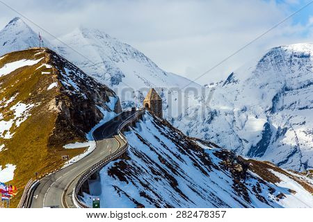 Turret at the turn of the road. Grand Austrian Alps. Alpine panoramic mountain road Grossglocknerstrasse. Snow melts. The concept of active, ecological and photo tourism poster