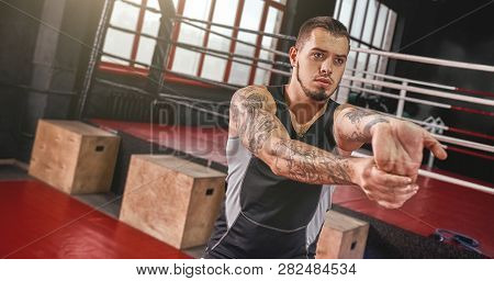 Warm Up Before Training. Close-up Of Young Muscular Athlete In Sports Clothing Warming Up Before Tra