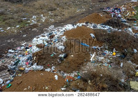 Aerial Top View Of A Large Pile Of Garbage. Pile Of Garbage On An Illegal Elemental Garbage Dump Or