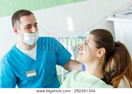 Mature Male Dentist Working With Woman Patient Visiting Dentist Having Dental Checkup At The Clinic