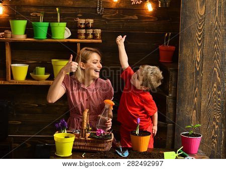 Floral Concept. Happy Mother And Child Give Thumbs Up Hands To Floral Arrangement. Little Son Help M