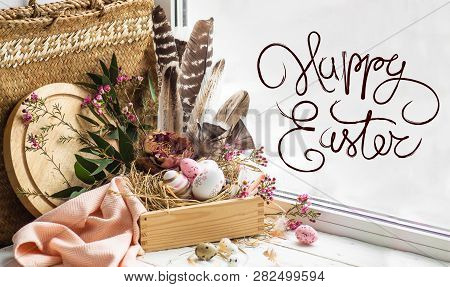 Happy Easter Background. Pink Easter Eggs In A Nest With Floral Decorations And Feathers Near The Wi