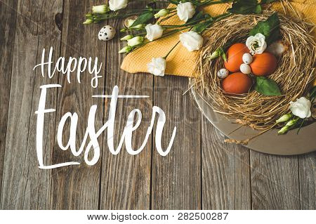 Happy Easter Background. Easter Eggs In A Nest On A Metal Plate On A Wooden Background. Happy Easter