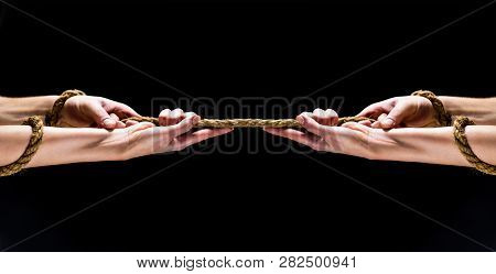 Man Hand Holding On To The Rope. Hand Holding A Ropes. Conflict, Tug-of-war, Rope. Rescue, Helping G