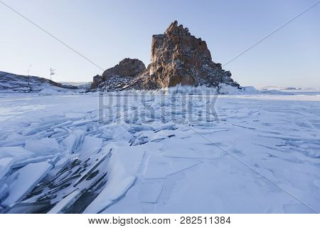 Ice On Lake Baikal Near Shamanka Rock, Winter Nature. Morning Landscape.