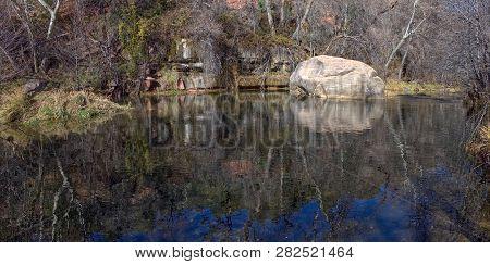 Tranquility Rock In Oak Creek. A Large Boulder Sitting In A Tranquil Section Of Oak Creek In Sedona