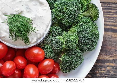 Homemade Buttermilk Ranch Salad Dressing With Dill Served With Fresh Cherry Tomatoes And Broccoli Ov