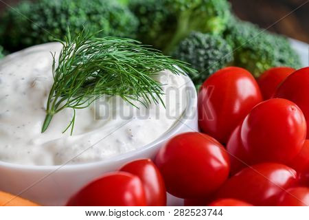 Homemade Buttermilk Ranch Salad Dressing With Dill Served With Cherry Tomatoes, Baby Carrots And Bro