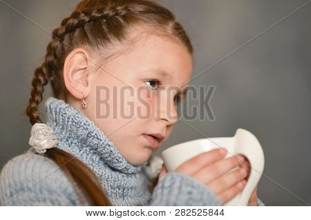 Cute Sick  Girl  With Cup Of Rea