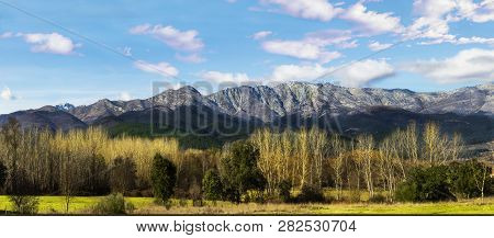 Panoramic Landscape Of Mountains With Trees And Blue Sky. Panoramic View Of The Sierra De Gredos, Sp