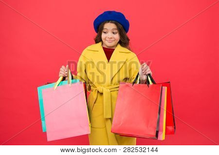 Prime Time Buy Spring Clothing. Obsessed With Shopping. Girl Cute Kid Hold Shopping Bags Red Backgro