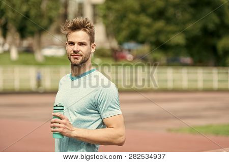 Staying Hydrated. Man Athletic Appearance Holds Water Bottle Keep Staying Hydrated During Training.