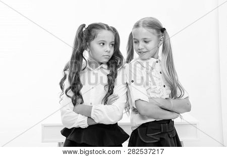 Little Girls In School Uniform Keep Arms Crossed. Back To School And Looking Good In New School Unif