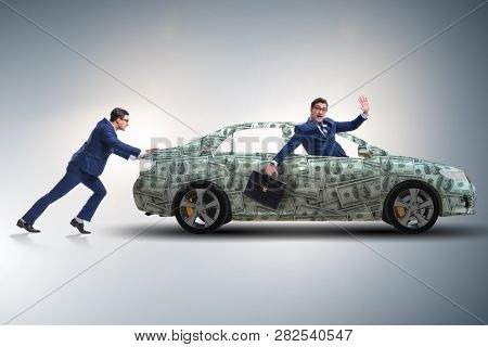 Businessman pushing car in business concept