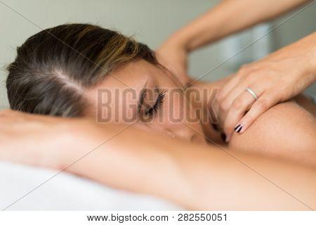Woman shoulders massage spa