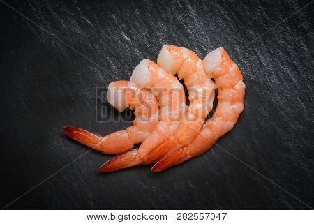 Shrimp On Dark Background / Seafood Shellfish Four Shrimps Prawns Boiled Cooked For Food On Table Di