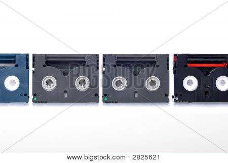 Picture of mini DV tape on white background poster