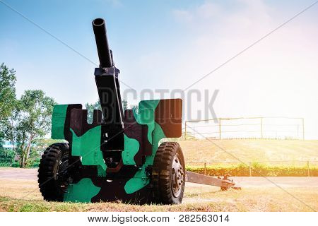 Old artillery cannon gun camouflage pattern / ordnance for soldier warrior in the world war in the park poster