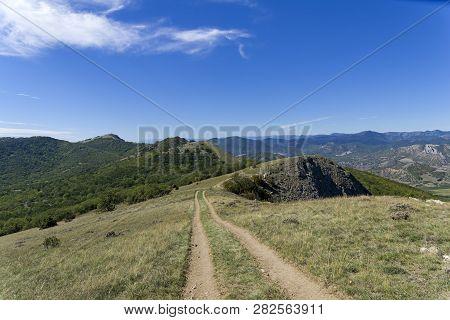 Dirt Road On Top Of A Mountain Range. Crimea, Tokluk Mountain Range, Sunny Day In September.