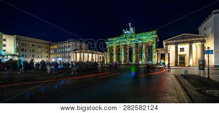 Berlin - October 07, 2018: Pariser Platz And Brandenburg Gate In Brightly Colored Illuminations. Fes