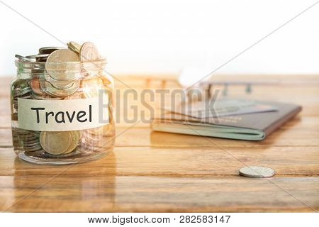 Travel Budget Concept. Travel Money Savings Concept. Collecting Money In The Money Jar For Travel. M