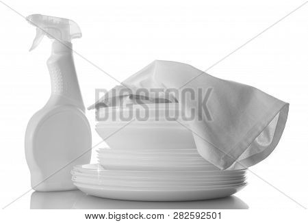 Clean Stack Of Dishes And Dishwashing Liquid, Towel Isolated On White Background