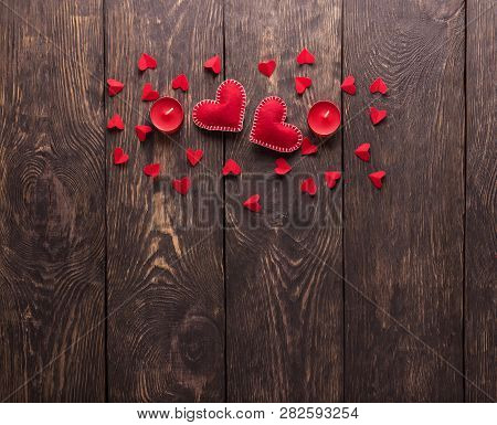 Red Handmade Hearts And Candles On A Dark Wooden Background