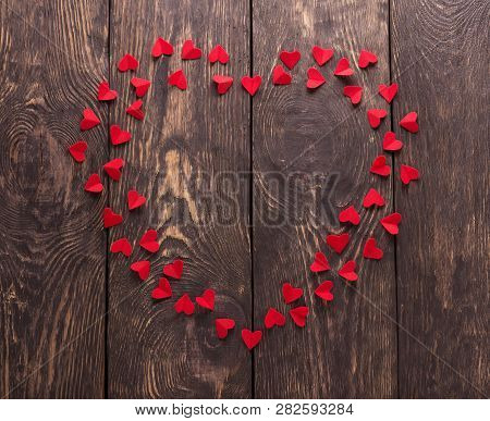 Happy Valentines Day. Beautiful Heart Of Small Red Hearts On Wooden Boards