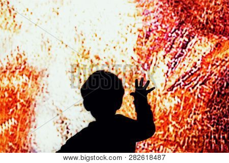 Child Touch The Big Screen. Child Hand Touches On The Colored Glass