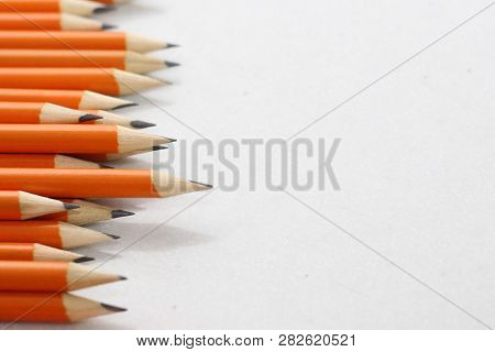 Simple Pencils For Office Workers. Pencils For Drawing. Pencils Are Scattered On A White Table And S
