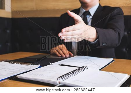 Employer Arriving For A Job Interview, Businessman Listen To Candidate Answers Explaining About His